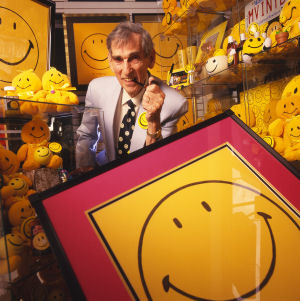 Ball posing with a selection of Smiley merchan...