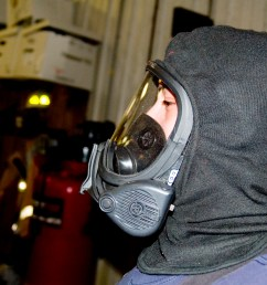 a person wearing an msa brand breathing mask with a nomex hood on this face piece attaches with a regulator to form a full scba  [ 3008 x 2000 Pixel ]