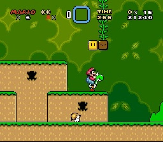 This screenshot shows Mario riding Yoshi during the first level of the game. The scenery shows a jungle environment with floating blocks scattered in the air. The interface displayed around the corners shows the number of lives the player has, the Dragon Coins collected, the player's stored power-up, the level's remaining time, the player's number of coins, and the total score of the player.