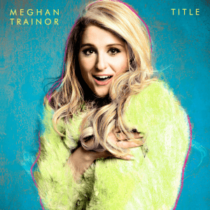 "A portrait of Meghan Trainor sporting a green fur jacket, posing afront a blue backdrop, with her name and the title, ""Title"" appearing in the portrait's corners."