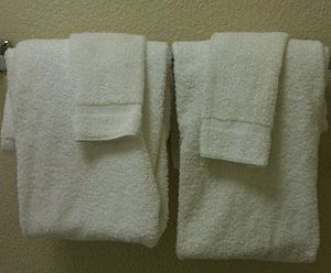 Towels on a rack in a hotel room