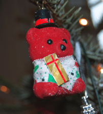 A photo of a bear decoration for a Christmas tree.
