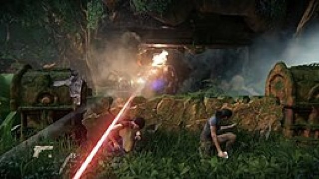 The player character is crouching, with her companion nearby. An enemy vehicle attacks in the distance.