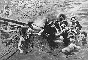 McCain being pulled from Truc Bach Lake in Han...
