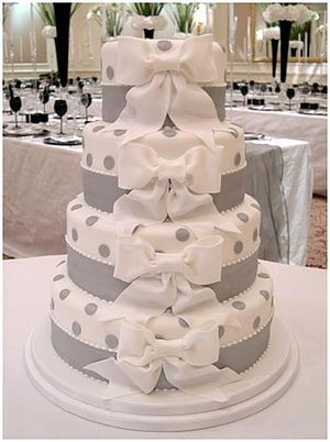 A contemporary white wedding cake decorated wi...