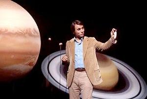 Sagan explains planetary orbits.