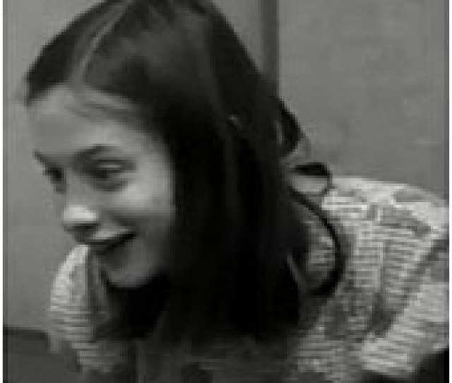 A Black And White Frame Taken From A Video Of Genie Who Is Enthusiastically Smiling