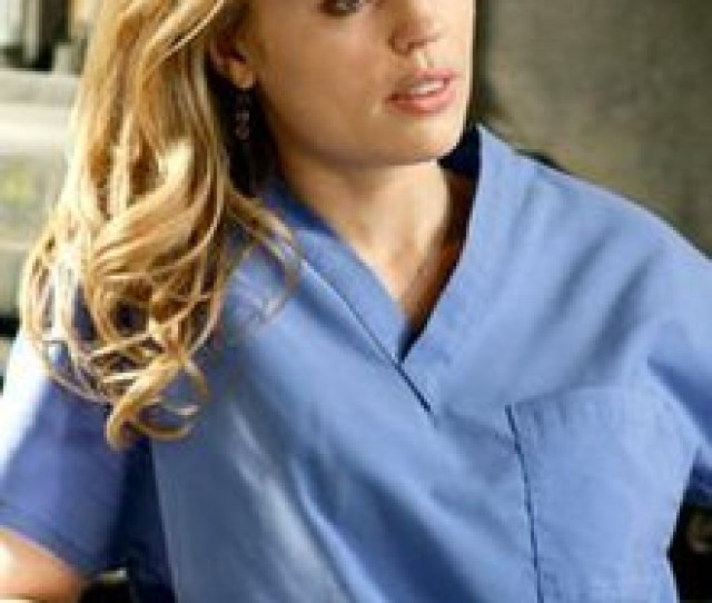 A Photo Of Sadie Harris In Blue Surgical Scrubs Melissa George