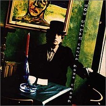A photograph of Dylan seated at a table wearing a top hat and tuxedo