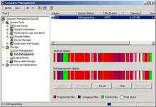 Konsol Windows 2000 komputer manajemen dapat melakukan banyak tugas sistem. Hal ini digambarkan di sini mulai disk defragmentation.