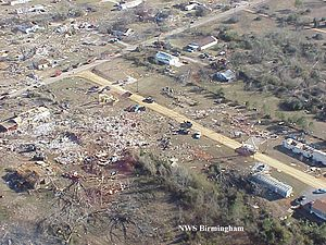 Damage to trees, homes and trailers south of T...