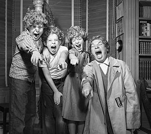 Harpo Marx and three of his children wearing H...