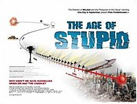 "A red timeline leads from the past into a ruined city scape. The film title ""The Age of Stupid"" is shown on the upper right in block capital blue writing"