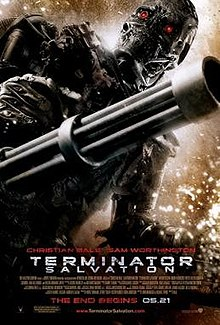 A skeleton-like machine with bright red eyes holding a gun in the background, while two men in battle fatigues, one of them holding a rifle, stand in the foreground. Below them are the credits, tagline and title.