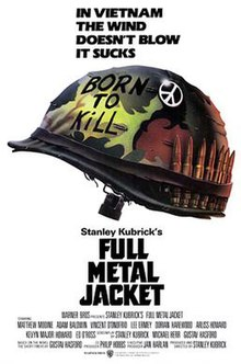 """Against a white backdrop is a camouflaged military helmet with """"Born to Kill"""" written on it, a peace sign attached to it, and a row of bullets lined up inside the helmet strap. Above the helmet are the words, """"In Vietnam the wind doesn't blow it sucks."""""""