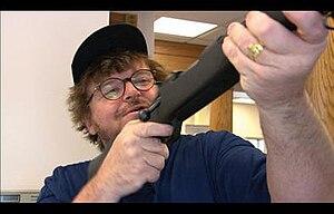 Michael Moore upon receiving his free gun at t...