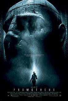 """A female figure in silhouette stands before an enormous statue of a humanoid head. Text at the middle of the poster reveals the tagline """"The Search For Our Beginning Could Lead To Our End"""". Text at the bottom of the poster reveals the title, production credits and rating."""
