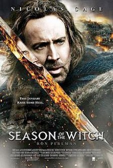 Film poster showing a close-up of Nicolas Cage in knightly garb and holding a sword. A witch's face and flames are seen in the blade's reflection.