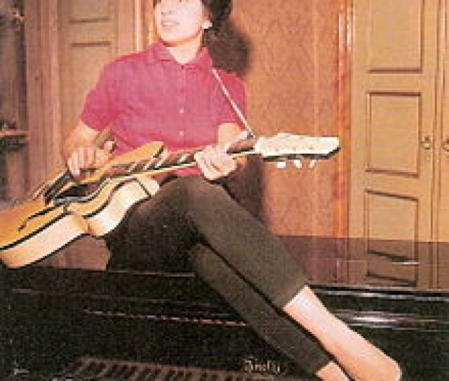 With Her Anelli Piano And A Giemmei Guitar At Home In Cremona