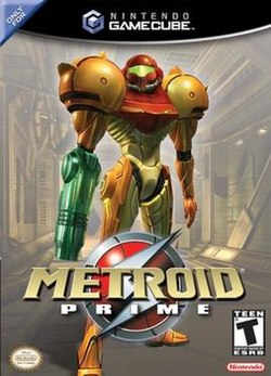"A person in a big, futuristic-looking powered suit with a helmet, a firearm on the right arm and large, bulky, and rounded shoulders, stands on a industrial-like corridor. Atop the image is the Nintendo GameCube logo, and the text ""Only for"" in the upper left corner. In the bottom of the image, the title ""Metroid Prime"" in front of an insignia with a stylized ""S"", the Official Nintendo Seal of Quality, Nintendo's logo, and ESRB's rating of ""T""."