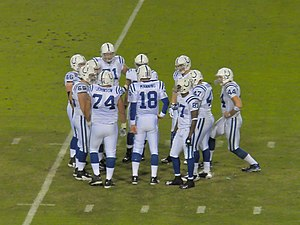 Manning in a huddle against the Jaguars