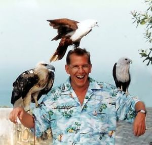 Jeff Woloson in Thailand. The birds atop Jeff'...