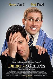 Steve Carell grinning maniacally stares from over Paul Rudd's shoulder