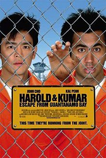 Harold Kumar Escape From Guantanamo Bay Two Men In Orange Jumpsuits Behind A Wire Fence