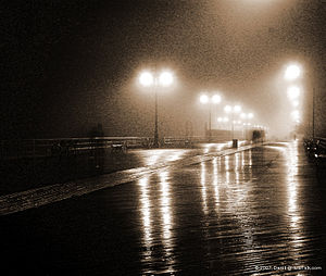 Coney Island, New York boardwalk on a foggy night.
