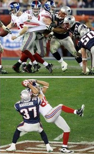 Eli Manning (top) breaking away from several d...