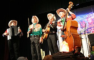Riders in the Sky appearing at the Ponca Theatre in Ponca City, Oklahoma on September 29, 2007 at a concert commemorating the 100th anniversary of the birth of Gene Autry. From left to right are Joey the Cow Polka King, Woody Paul, Ranger Doug and Too Slim.