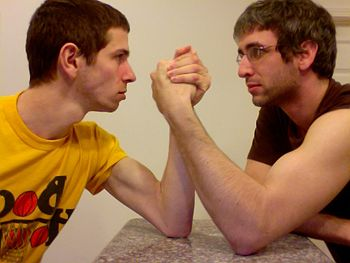 Two young men arm wrestling