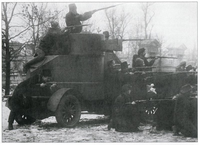 """Historical Photo of P. Otsup. Armored car """"Lieutenant Schmidt"""", captured by the Red Guards in the cadets. Petrograd, October 25, 1917."""