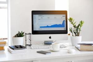 content management analytics displayed on desktop of website and social media performance
