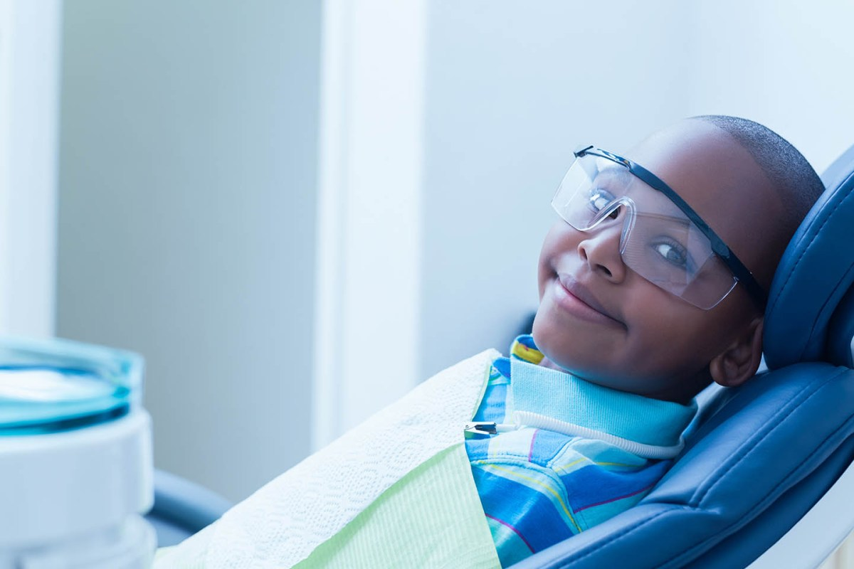 boy in dentist chair wearing goggles