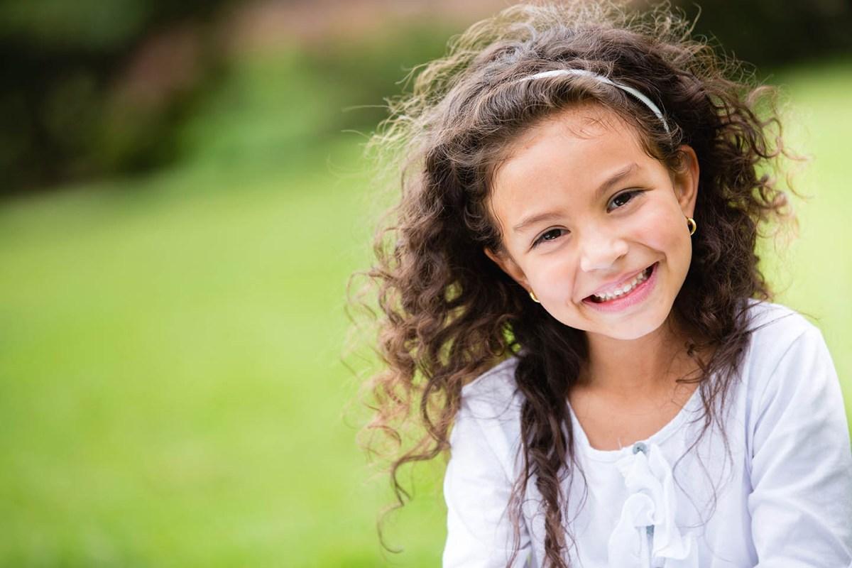 girl smiling in field