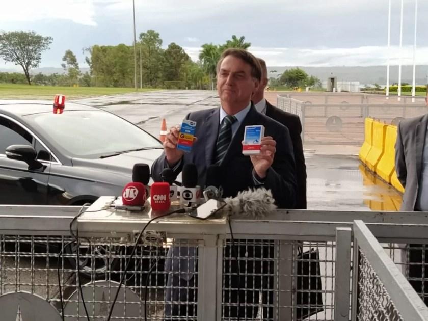 President Jair Bolsonaro holds hydroxychloroquine box