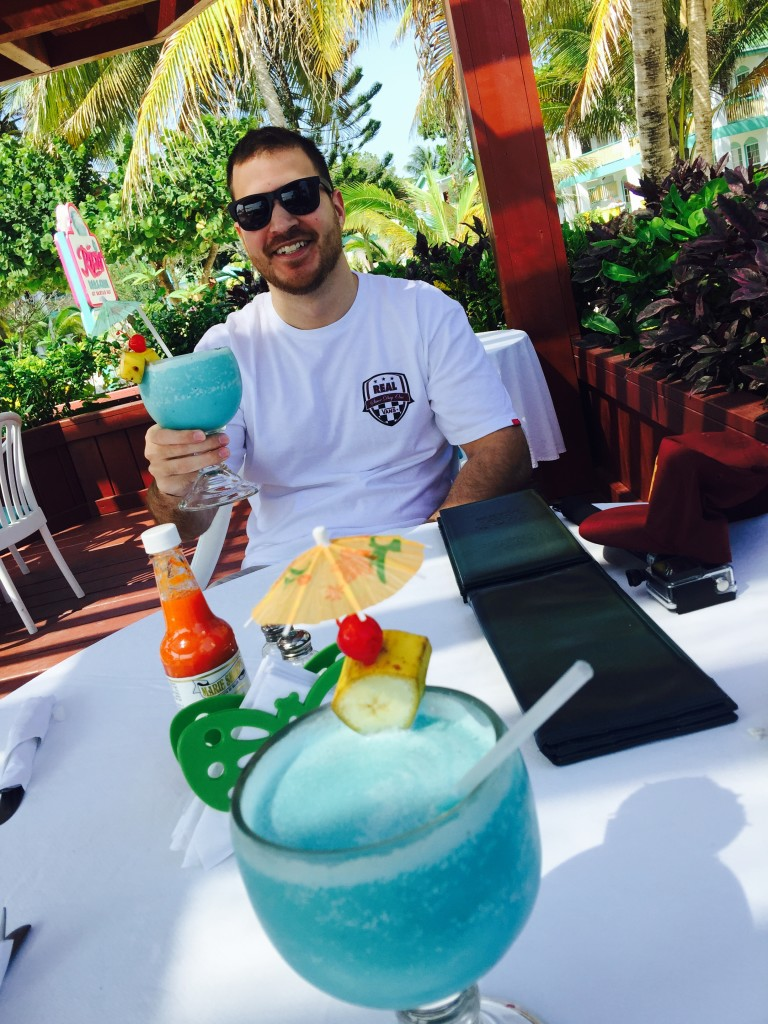 Man with blue drink