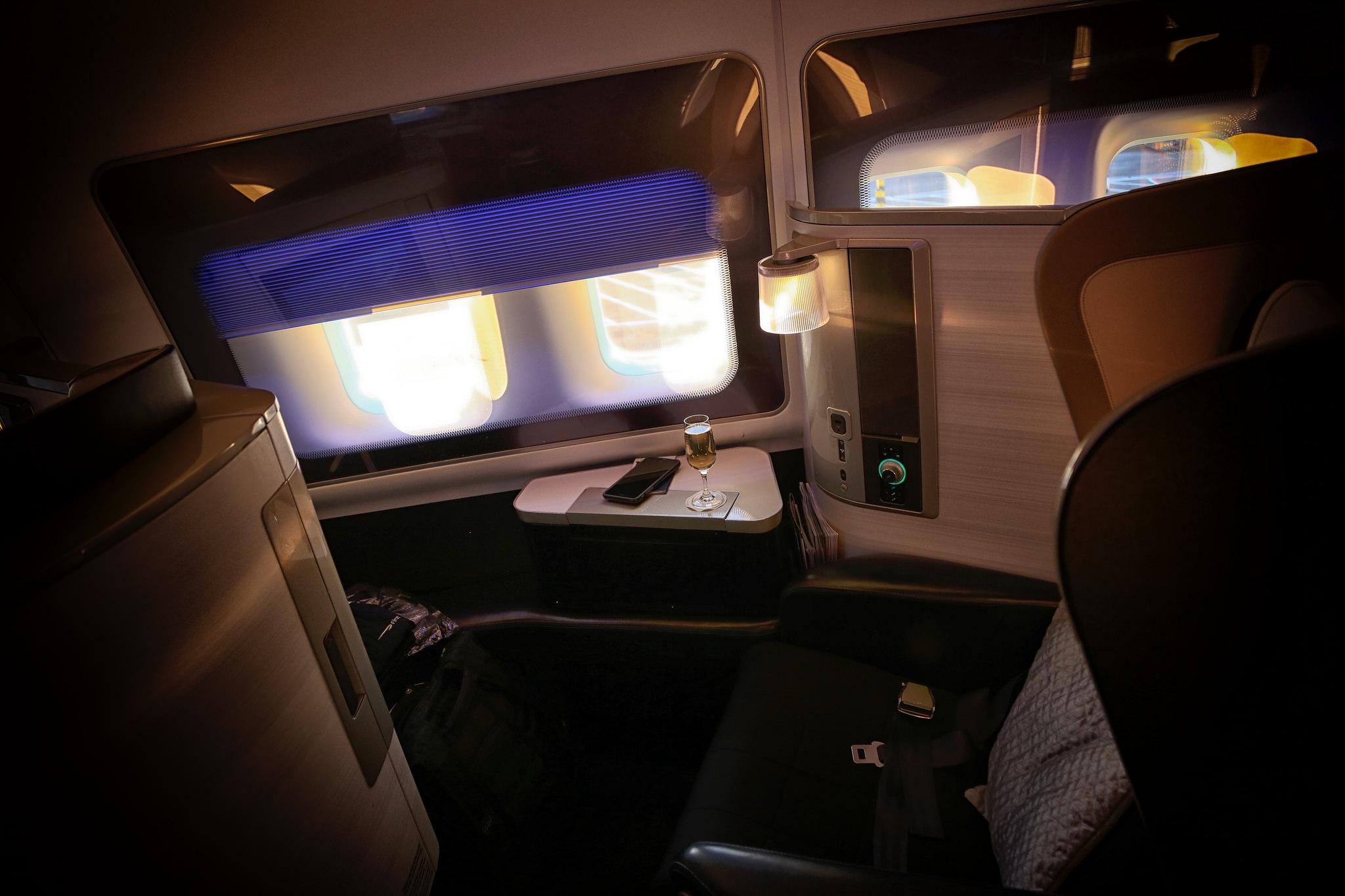 First class seat on British Airways with window shades halfway down