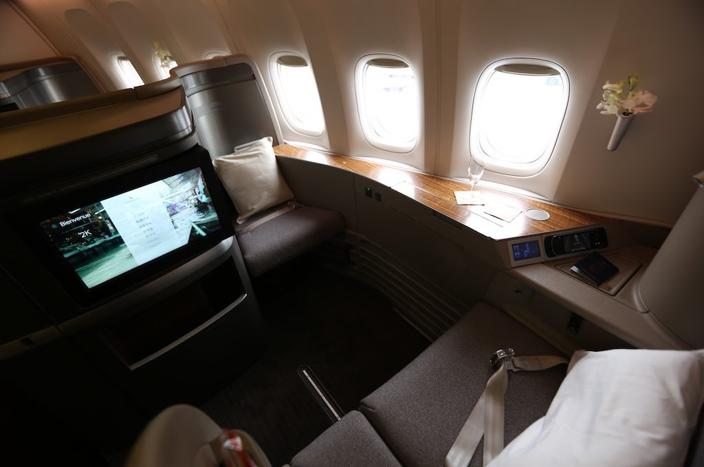 Cathay Pacific first class seat with  three windows