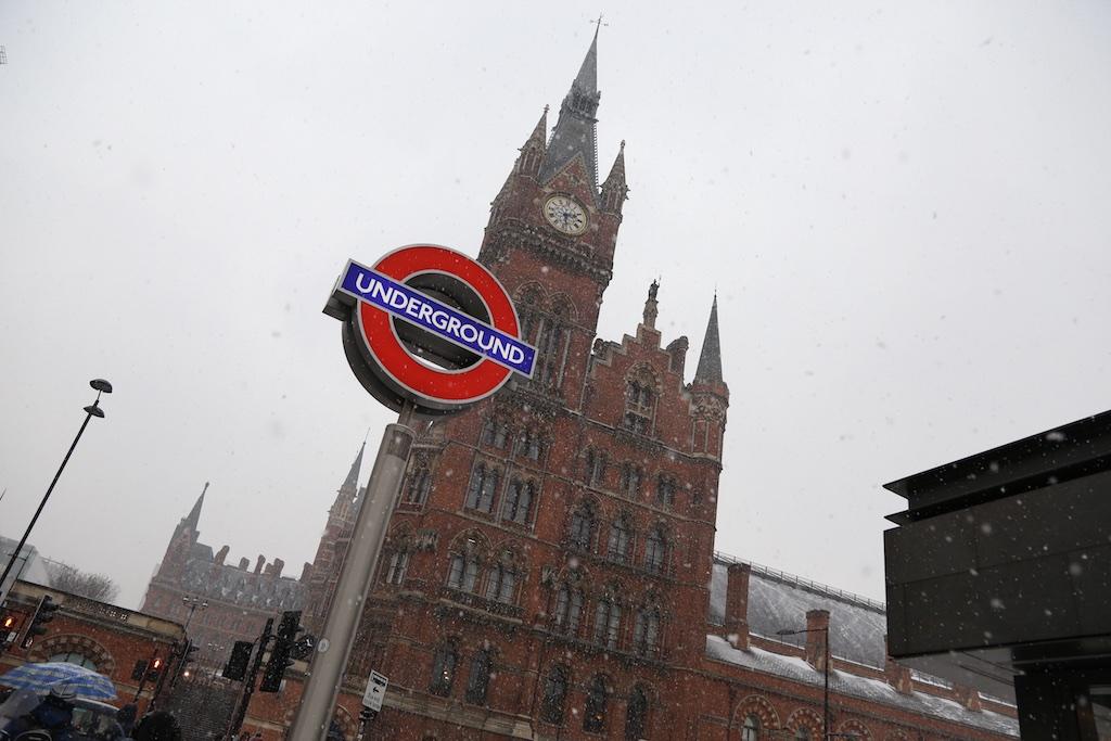 A picture of it snowing outside the St. Pancras Renaissance Hotel London.