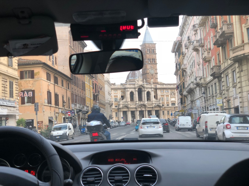 Picture looking out from a taxi cab in Italy near a train station