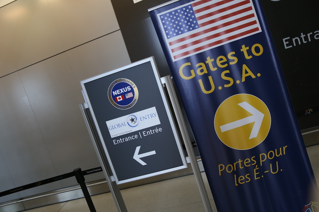 Picture of a global entry sign at an airport.