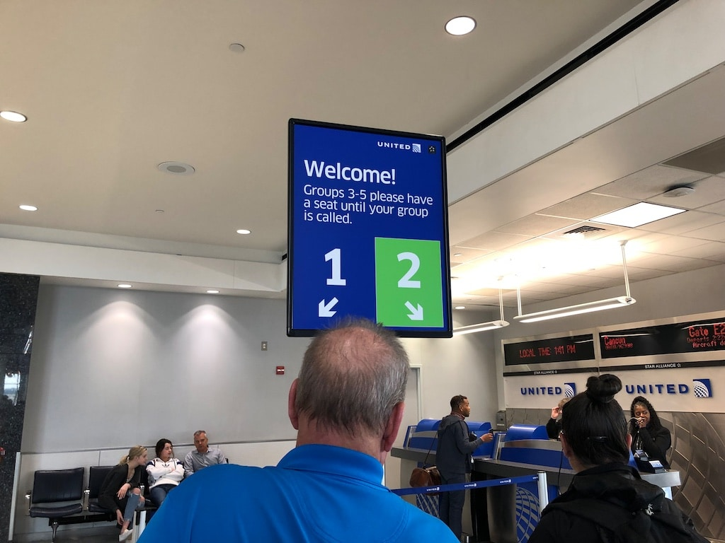 A photo of the united boarding sign
