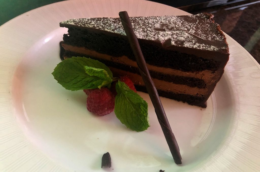 Chocolate cake with mint and raspberry garnish at The St. Regis Houston.