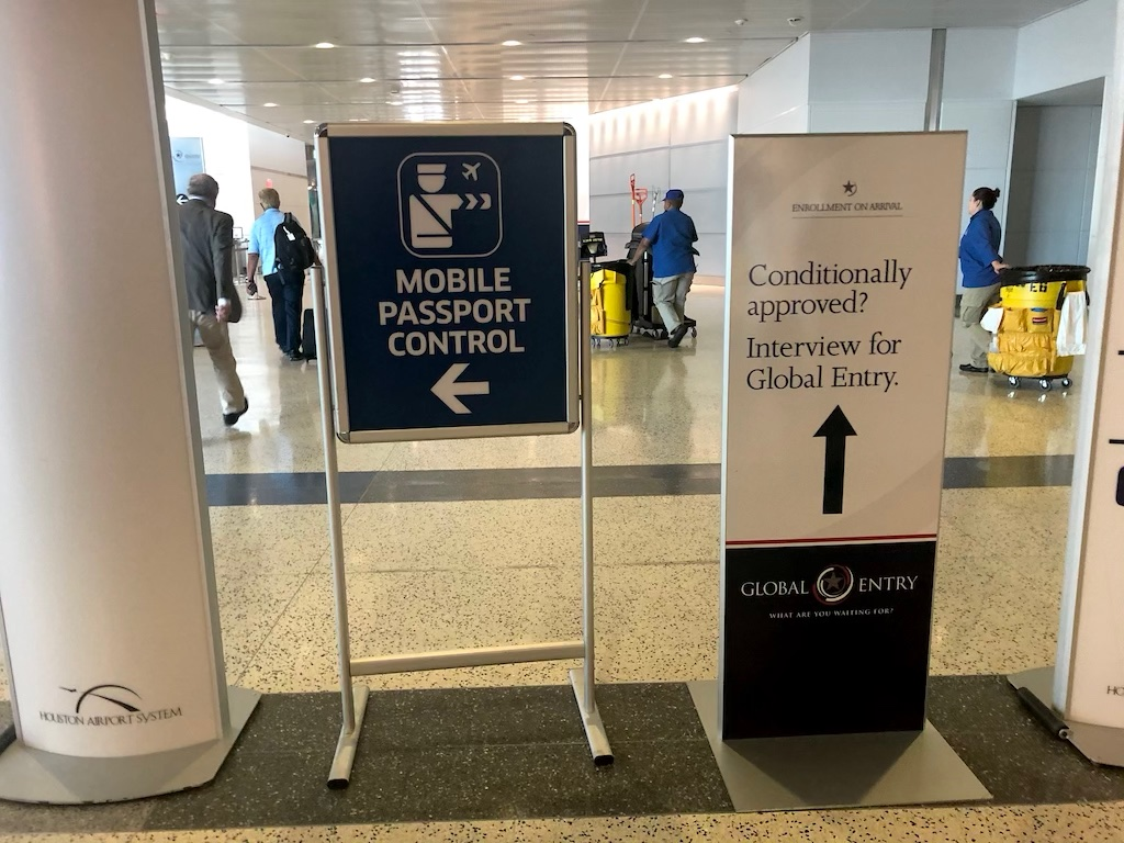 Picture of a global entry enrollment on arrival sign.