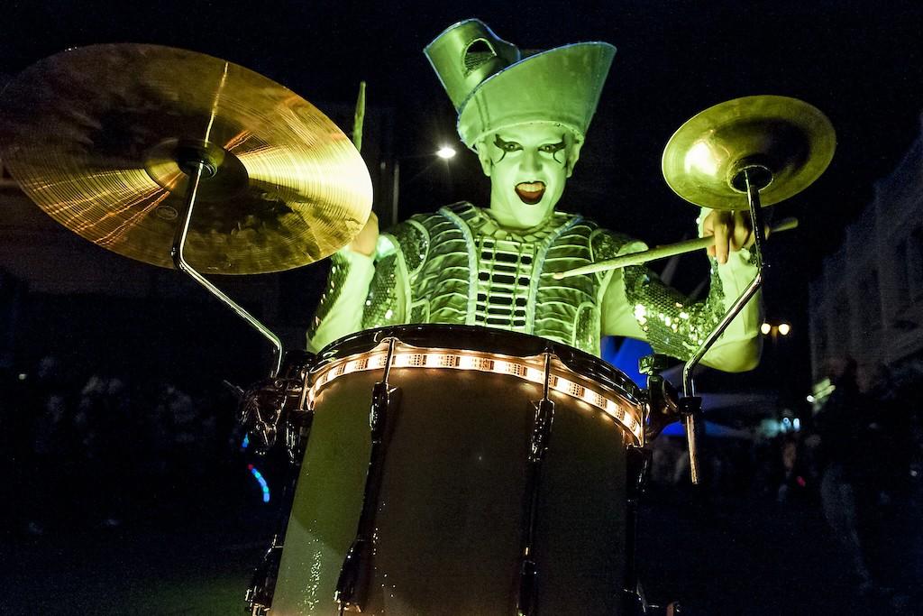 Drummer in green