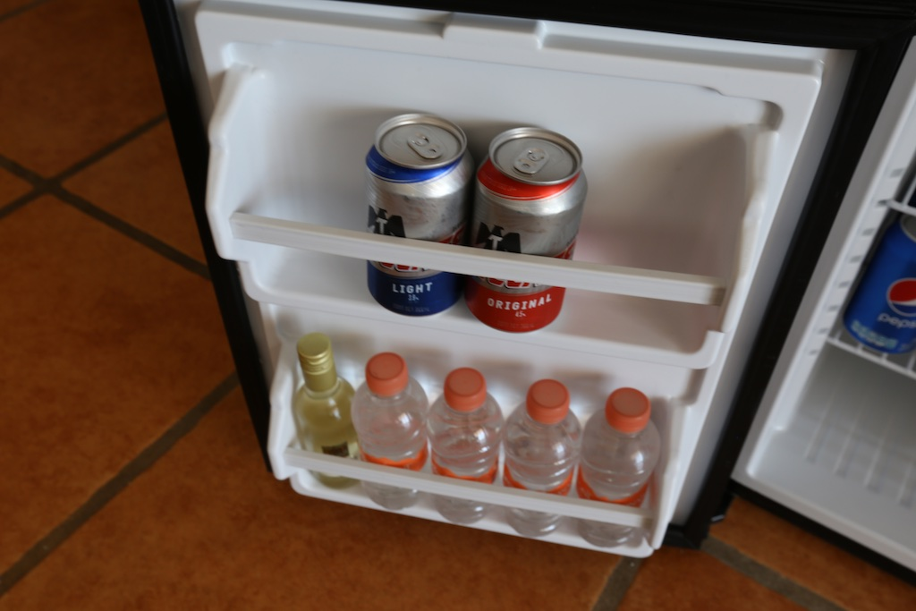 Picture of a mini fridge with beverages