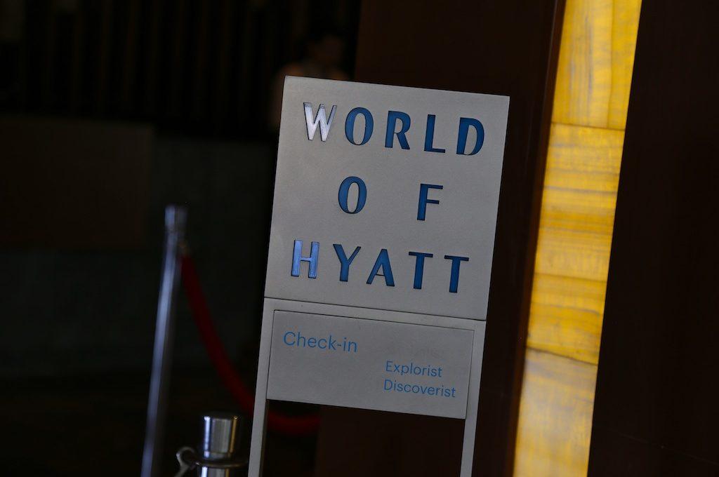 hotel check-in sign for Hyatt elite members