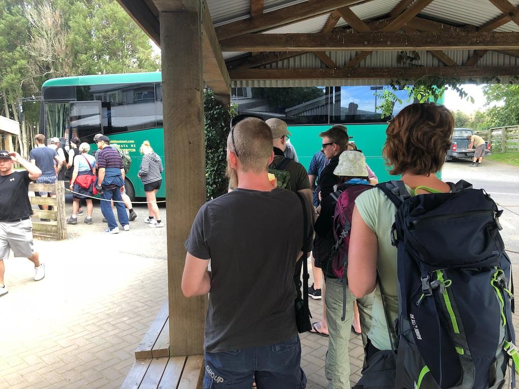 Group getting on bus at Hobbiton Movie Set Tour